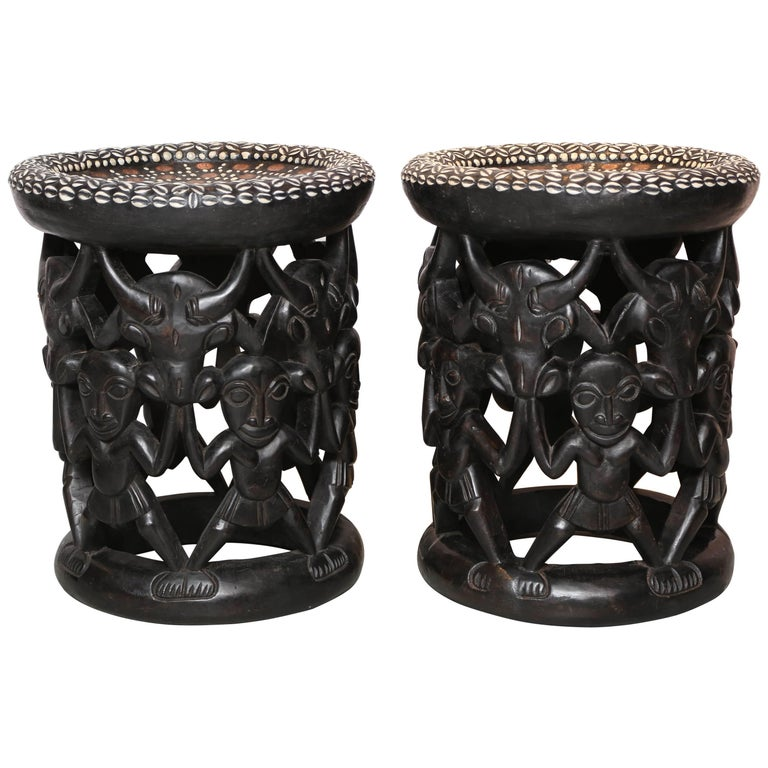 Pair of African Side Tables Extensive Woodcarving Top Inlaid Coins, Cowry Shells For Sale