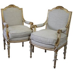 Pair of 20th Century Carved Painted and Gilt Upholstered Open Armchairs