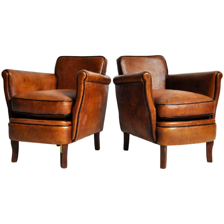 "Pair of ""Submarine"" Brown Leather Club Chairs with Dark Piping"