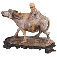 A Chinese Carved Soapstone Sculpture Of A Child On A Water Buffalo