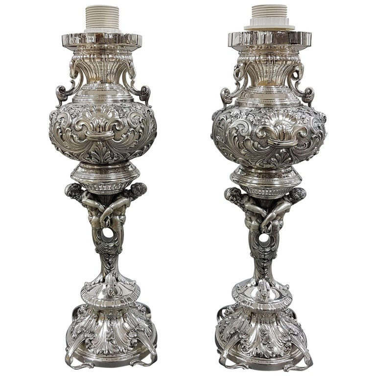 20th Century Pair of Italian Silver embossed with figures Lamps