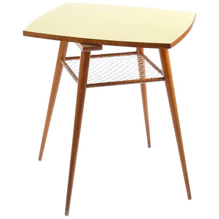 midcentury coffee table with yellow rotating formica topboard