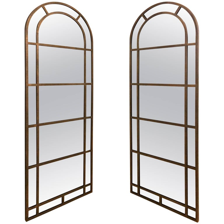 Pair of Distressed Copper Decorated Arch Top Standing Peir or Console Mirrors