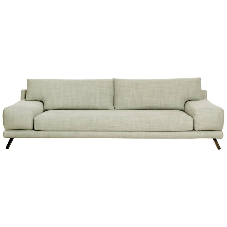 Sofa Ian in fabric and brass by French designer Christophe Delcourt