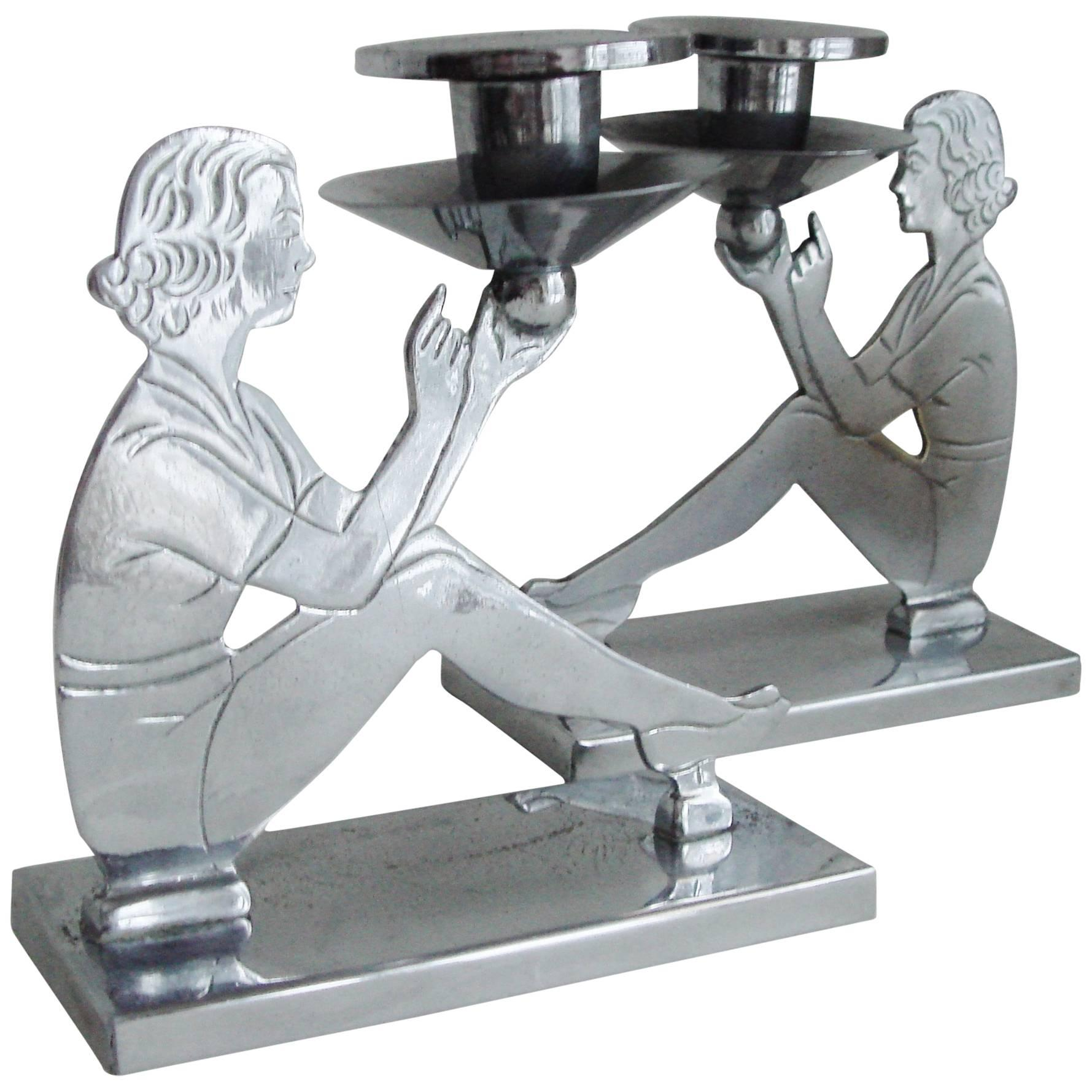 Pair of English Art Deco Chrome Figurative Seated Female Candlesticks