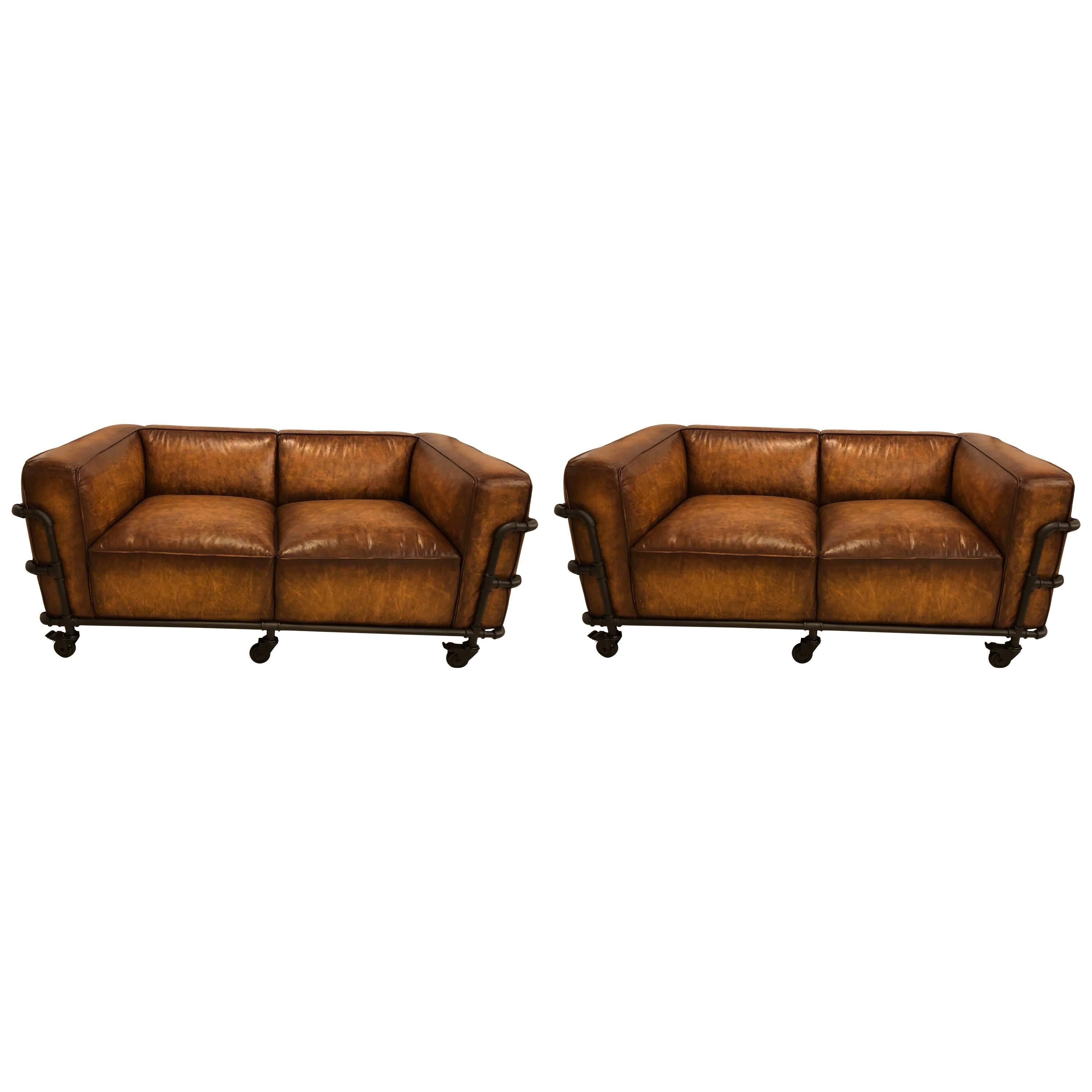 Superb Pair Of Industrial Style Sofas On Metal Frame Piping With Casters For Sale