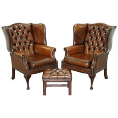 Pair of Hand-Dyed Cigar Brown Leather Chesterfield Wingback Armchairs and Stool