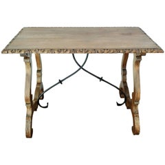 19th Spanish Farm Table with iron stretchers & hand carved top