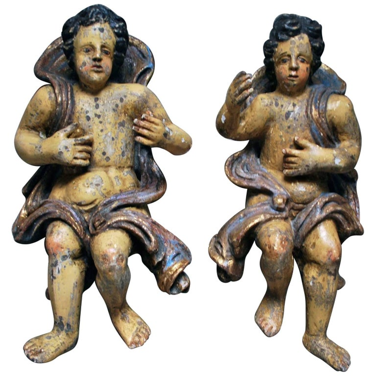 Large pair of 17th Century Polychromed Carved Wood Cherubs