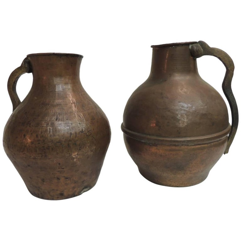 Pair of Heavy Patina Persian Copper Water Jugs with Handles