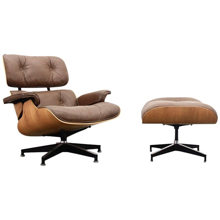 Eames Lounge Chair And Ottoman In Walnut Brown Leather 1970s For