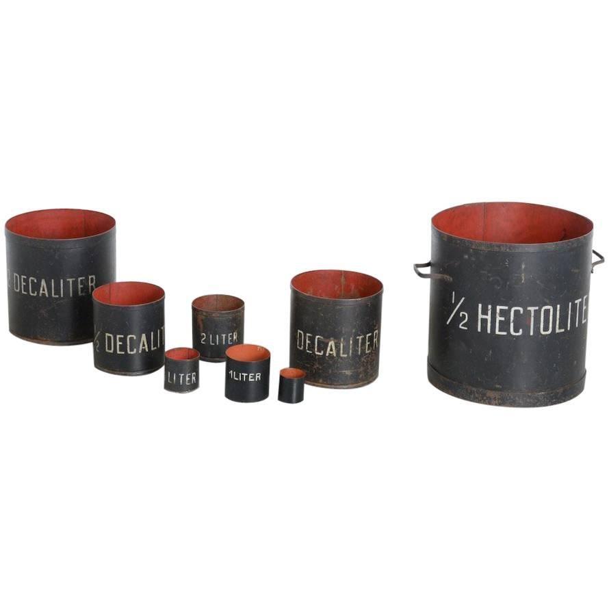 Decorative Set of 8 Vintage Metal Measuring Cups