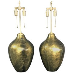 Pair of Luminescent Gold and Black Glazed Orbs with Lamp Application
