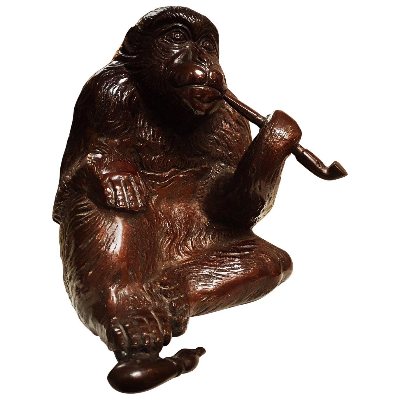 A Japanese Bronze Monkey Smoking A Pipe