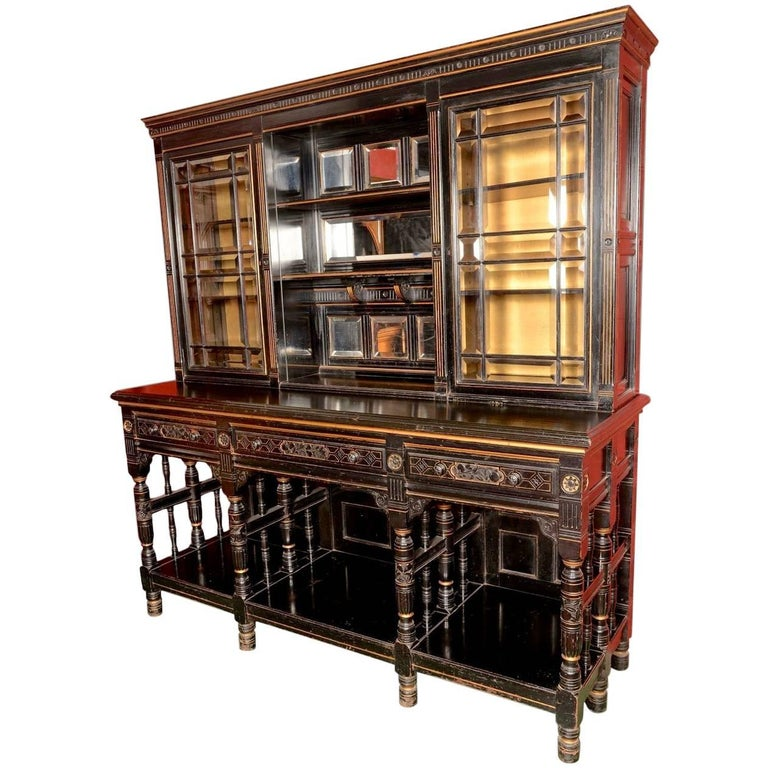 An Aesthetic Movement Ebonised Parcel-Gilt Display Or