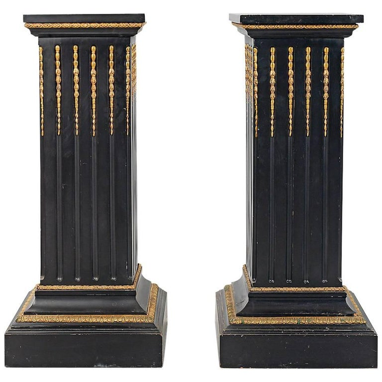 Set of Two Neoclassical Style Ebonized Wood and Gilt Bronze Pedestals For Sale