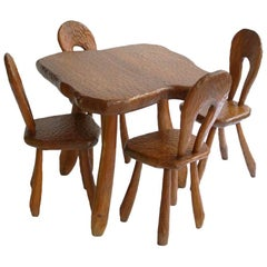 Table and Four Chairs in the Style of Atelier Marolles