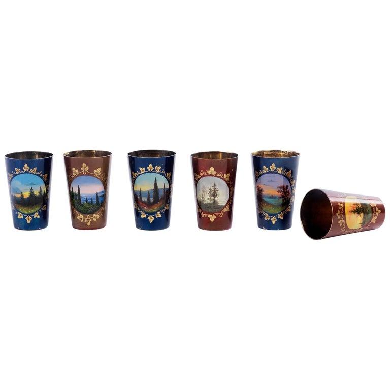 Six Silver Gilt Russian Vodka Cups with Enamel Landscape Scenes For Sale