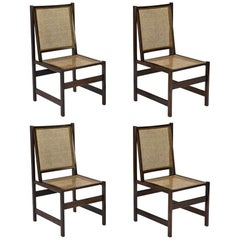 Brazilian 1960s chairs in Jacaranda and cane, attributed to Joaquim Tenreiro