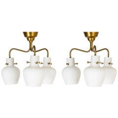 Pair of Brass and Opaline Chandeliers by Hans Bergström