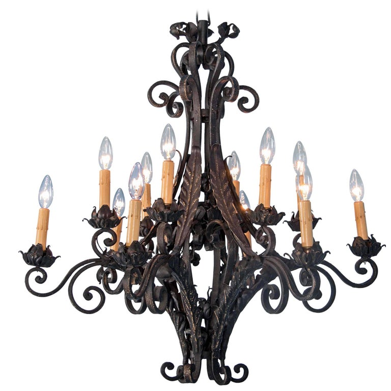 Antique French Twelve-Light Wrought Iron Chandelier For Sale