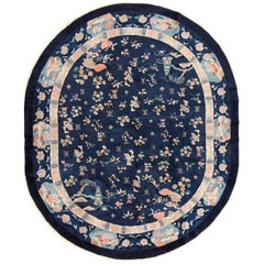 Oval Antique Navy Background Chinese Rug