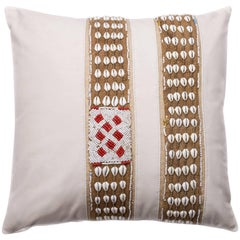 Antique African Trim on White Matte Leather Pillow