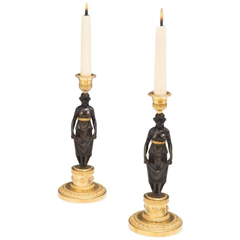 Fine Pair of Ormolu and Bronze Figurine Candlesticks