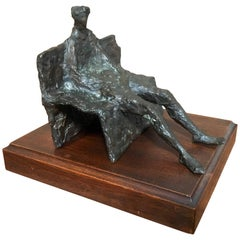 Abstract Bronze Sculpture of Man on a Bench
