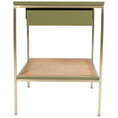 Re: 392 Bedside Table in Serpentine Green on Satin Brass frame with Caned shelf