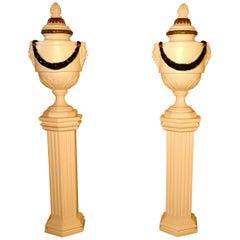 Pair of French Urns Set on Classical Column Pedestals