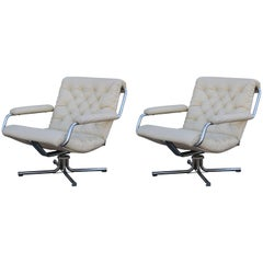 Pair of Cream Tufted Leather and Chrome 1970s Swivel Chairs