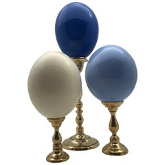 Lacquered and Natural Ostrich Eggs Mounted on Brass Bases