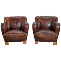 Pair of Early Danish Lounge Chairs in Leather