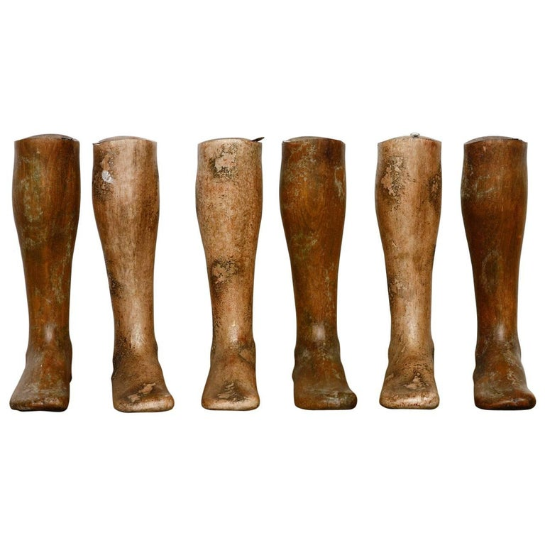 Fabulous set of six, 19th century wooden riding boot molds or boot forms. Features a solid hardwood construction and all six similarly sized. Each has a hook on the top allowing them to be hung on a wall for display. They all have a beautifully