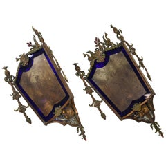 Pair of 1920s Bronze Corner Mount Sconces with Blue Flashed Glass