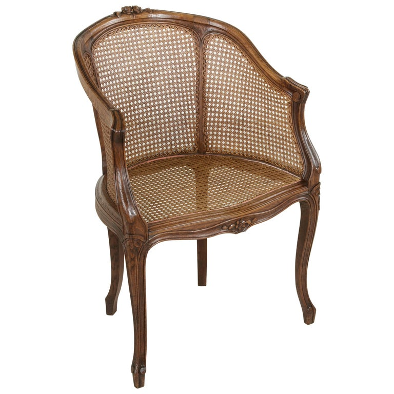 Early 20th Century French Louis XV Style Hand-Carved Oak and Caned Bergere