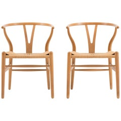 Hans J. Wegner Set of Four Wishbone Chairs in Oak for Carl Hansen
