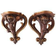 Pair of Antique Italian Baroque Cherub Painted and Gilt Gesso on Wood Sconces