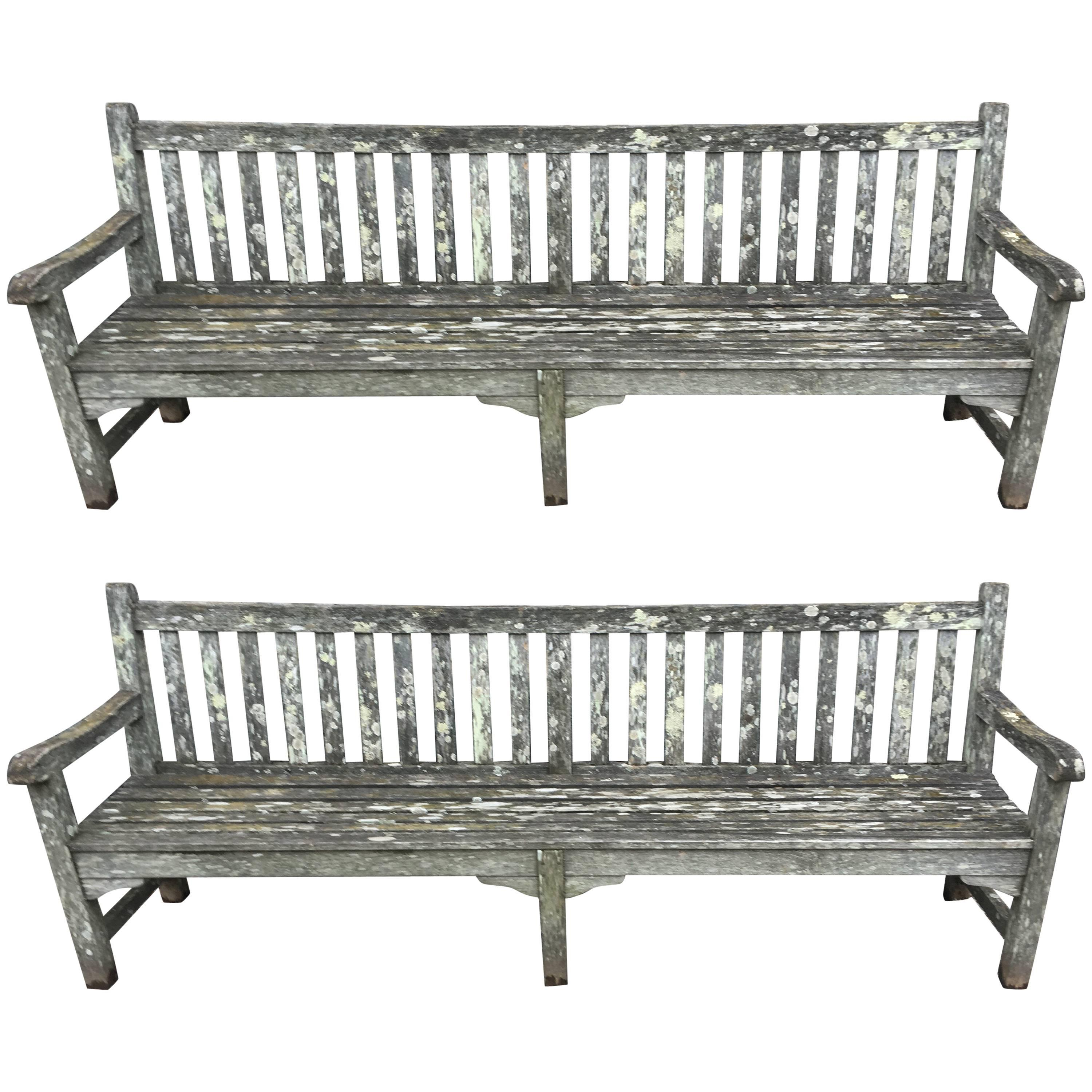 Pair Of Very Long Heavily Lichened English Teak Garden Benches For Sale