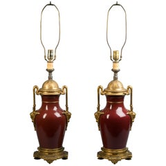 Pair of Gilt Bronze Mounted Sang De Boeuf Vases Mounted as Lamps, circa 1860