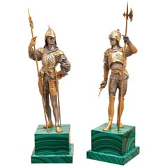 Pair of Silvered and Gold Bronze Medieval Soldier Statues on Malachite Base