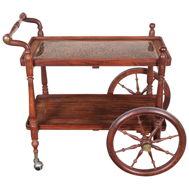 Carved wood and glass serving cart for sale at stdibs