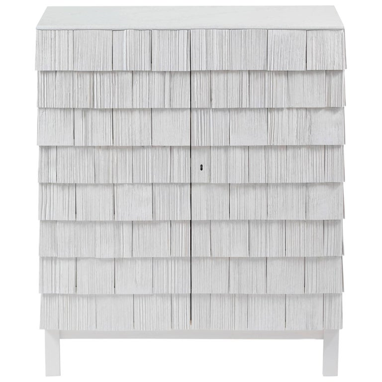 Light grey cabinet from Ringvide, Pine Shingles pine wood and top of lime stone