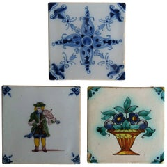 Three 19th Century Dutch Delft Ceramic Wall Tiles, Violin Player and Two Floral