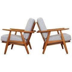 Pair of Hans Wegner Oak 'Cigar' Lounge Chairs Model GE-240 GETAMA, Denmark
