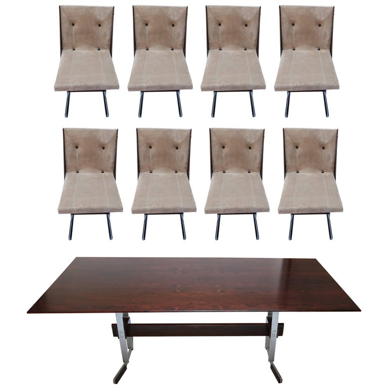 Brazilian jacaranda and metal dining table and eight chairs from the 1960s attributed to Jorge Zalszupin, upholstered in beige suede. 