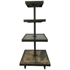 Industrial 4 tier rolling display stand,distressed finish.Dayton Display Co.