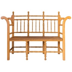 Edwardian Style Light Oak Spindle Bench with Rush Seat and Curved Arms