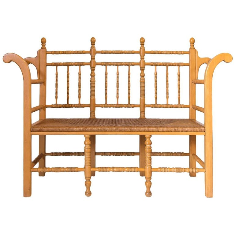 Edwardian Style Light Oak Spindle Bench with Rush Seat and Curved Arms For Sale